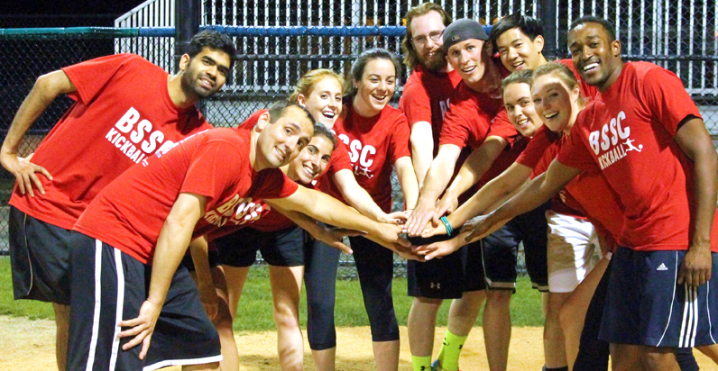 BSSC Sports Coed Kickball HappyRed Team Hands in for Cheer